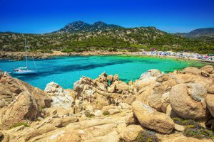 Cala Cipolla, Chia beach with red stones and azure clear water. Sardinia is the second largest island in the Mediterranean Sea.